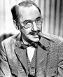 Groucho Marx with a cigar in his mouth and a bow tie